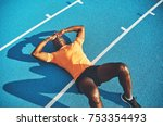 exhausted young athletic... | Shutterstock . vector #753354493