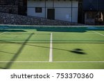 an empty tennis court  with a