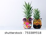 ripe pineapples with glasses on ... | Shutterstock . vector #753389518