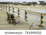 three fishing rods leaning... | Shutterstock . vector #753390520