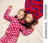 girl sisters in pajamas lie in... | Shutterstock . vector #753395500