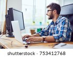 smiling young developer typing... | Shutterstock . vector #753412768