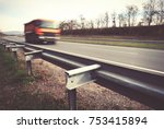 truck driving on asphalt road | Shutterstock . vector #753415894