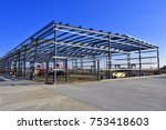 Steel frame commercial building under construction. - stock photo