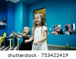 funny little girls with blonde... | Shutterstock . vector #753422419