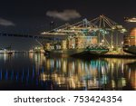 Small photo of SAN PEDRO, CALIFORNIA - NOVEMBER 10, 2017: Dock workers at the Port of Los Angeles continue to load and unload Evergreen cargo freighters. Day and night, the work continues.