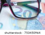 Small photo of Twenty euros to the European Union photographed close-up. High resolution photo. Twenty euros. Twenty euros under the glasses.
