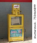 Small photo of SHAWNEE, OKLAHOMA—Photo of a yellow steel dispenser of a newspaper placed outside a store in Shawnee taken in November 2017.