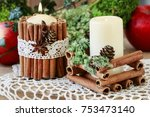 candle decorated with cinnamon... | Shutterstock . vector #753473140