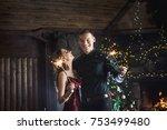 joyful couple near christmas... | Shutterstock . vector #753499480