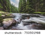 Mountain River Flowing In A...