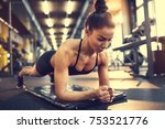 woman in plank pose in gym | Shutterstock . vector #753521776