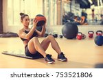 fit sportswoman doing exercise... | Shutterstock . vector #753521806