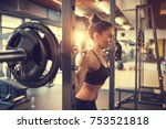 fit beautiful girl doing squats ... | Shutterstock . vector #753521818