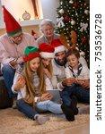 family enjoying their holiday... | Shutterstock . vector #753536728