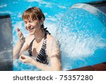 woman standing in pool  narrows ... | Shutterstock . vector #75357280
