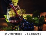 dry red wine pouring into glass ... | Shutterstock . vector #753580069