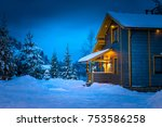 Snow Covered Cottage.