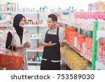 attractive female muslim... | Shutterstock . vector #753589030