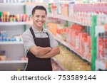 happy young male staff working... | Shutterstock . vector #753589144