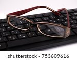 glasses on keyboard isolated on ... | Shutterstock . vector #753609616