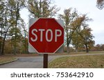 stop sign near forked road and... | Shutterstock . vector #753642910