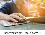 man is using the computer to... | Shutterstock . vector #753656953