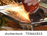 a worker grinding off a rivet | Shutterstock . vector #753661813