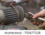 detail of hands working on... | Shutterstock . vector #753677128