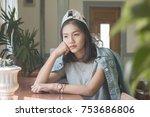 sad asian women sitting in cafe ...   Shutterstock . vector #753686806