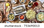 dining table with a variety of... | Shutterstock . vector #753690013