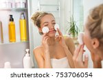 young beautiful woman cleaning... | Shutterstock . vector #753706054