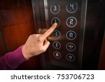 woman pressing the button in... | Shutterstock . vector #753706723