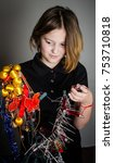 Small photo of Child with tangle christmas decorations.