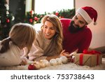 girl opening a present on a... | Shutterstock . vector #753738643
