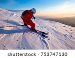 a skier is riding on the slope. ... | Shutterstock . vector #753747130