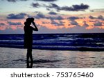 little girl by the sea at sunset | Shutterstock . vector #753765460