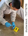 Small photo of Forensic expert collects evidence. Crime scene investigation