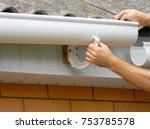 contractor installing plastic... | Shutterstock . vector #753785578