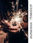 hand holding a burning sparkler ...   Shutterstock . vector #753833119