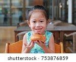 adorable little asian girl... | Shutterstock . vector #753876859