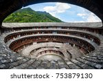 Small photo of fujian tulou (hakka roundhouse). The Red paper with chinese words are couplets with lucky poem