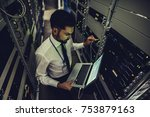 handsome man is working in data ... | Shutterstock . vector #753879163