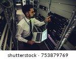 handsome man is working in data ... | Shutterstock . vector #753879769