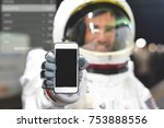 an astronaut dressed man uses... | Shutterstock . vector #753888556
