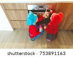 little boy and girl cook and... | Shutterstock . vector #753891163