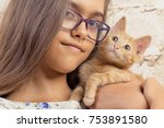 Stock photo girl with a favorite kitten young beautiful girl is holding a red kitten lovely portrait of a 753891580
