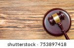 wooden gavel with stand on