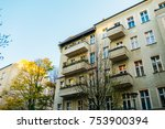 houses in a street at autumn... | Shutterstock . vector #753900394