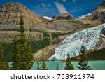 berg glacier falling into berg...